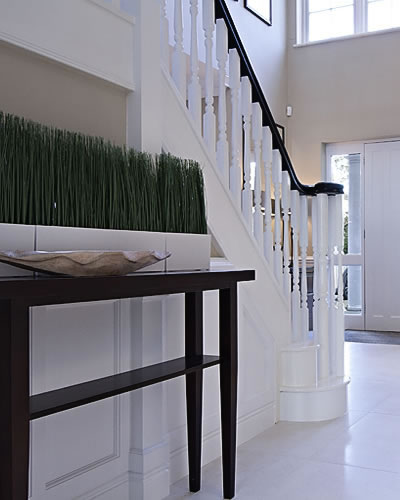 Entrance hall table and bannister